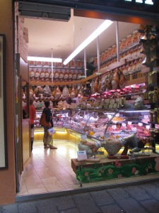 Shop selling loads of Proscuttio for those wanting to take a whole pig leg away